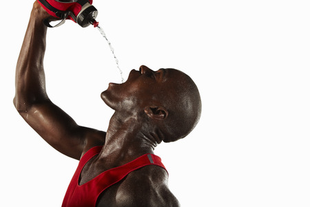 Athlete pouring water into his mouth