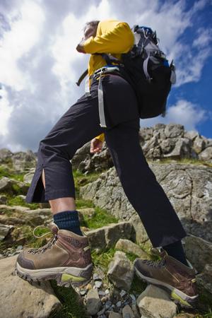 ascends: Woman hiking on rocky hillside