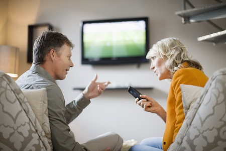 arguement: Couple arguing over remote control