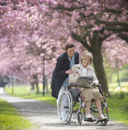Older woman with caretaker in park