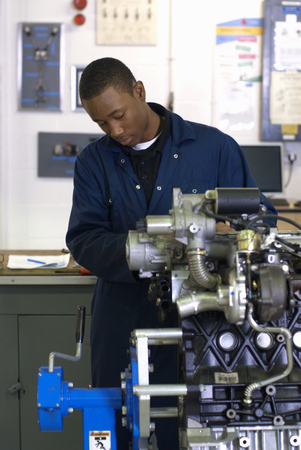 auto focus: Student working on car engine