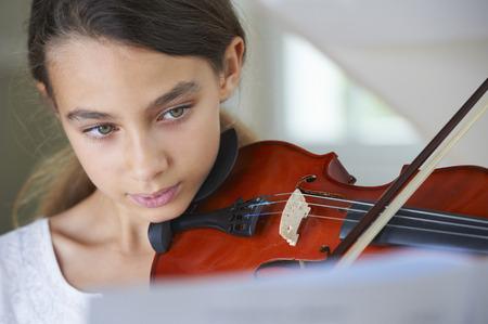 Serious girl playing violin
