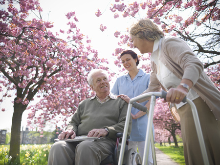 faiths: Older couple with caretaker in park LANG_EVOIMAGES