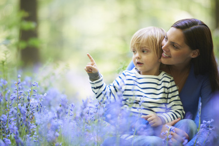 regard: Mother and son in field of flowers LANG_EVOIMAGES