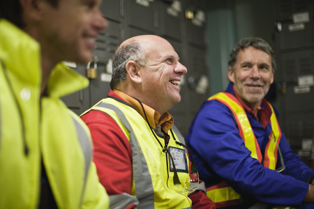 mans watch: Workers sitting in locker room LANG_EVOIMAGES