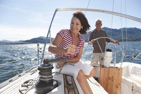 Older couple sailing together LANG_EVOIMAGES