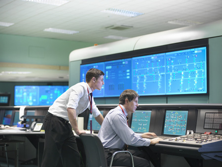 assessed: Operators in power station control room LANG_EVOIMAGES