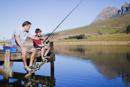 midsummer pole: Father fishing with son in lake LANG_EVOIMAGES