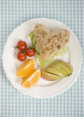 heartshaped: Plate of bread,fruit and vegetables