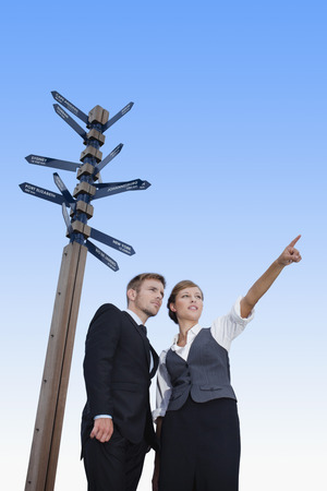 complicated journey: Business people at crossroads
