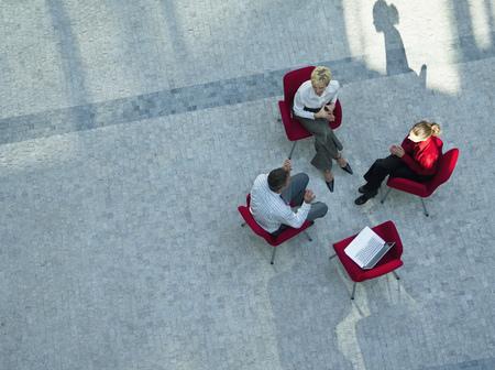 talker: Business people having meeting in atrium