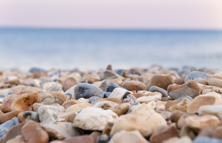 Close up of pebbles on rocky beach