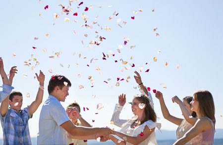 enthusiastically: Friends celebrating newlywed couple