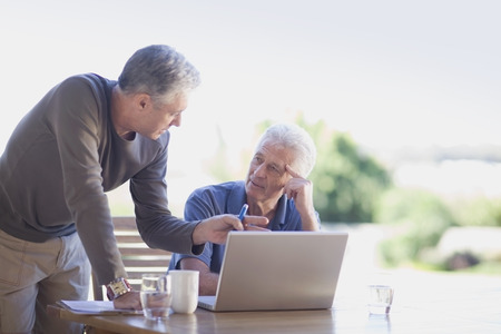 taught man: Older men using laptop together