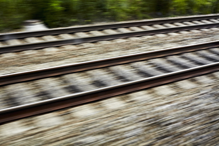 rushed: Blurred view of train tracks