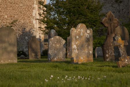 headstones: Old headstones in church graveyard