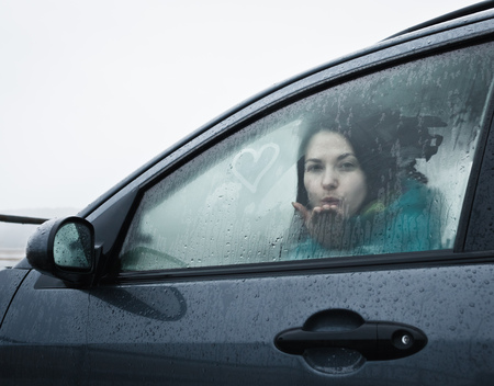 saturating: Teenage girl blowing kiss from car
