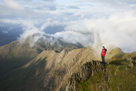 the magnificent: Hiker overlooking view from mountaintop