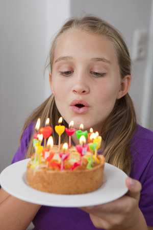 blazed: Girl blowing out birthday candles