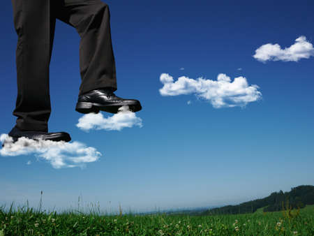 enlarged: Businessman walking on clouds LANG_EVOIMAGES