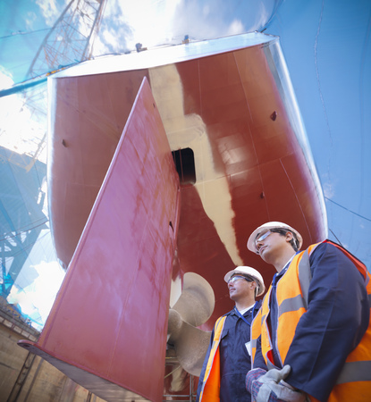 shipped: Workers standing on shipbuilding site