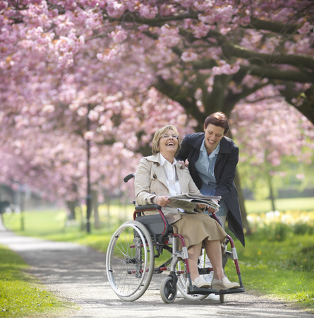 caregivers: Older woman with caretaker in park