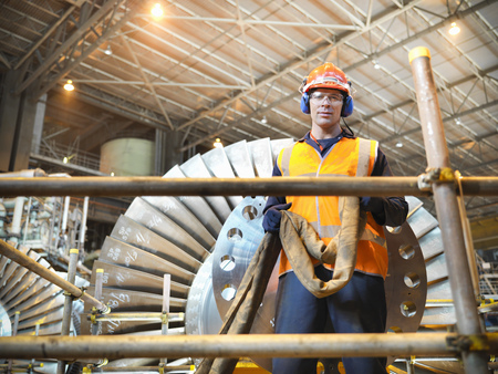 Worker with turbine in power station