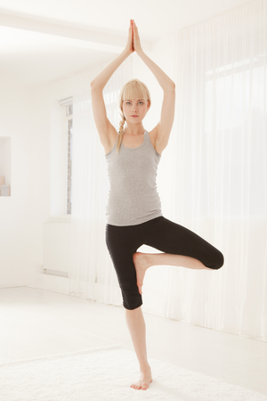 Woman practicing yoga LANG_EVOIMAGES