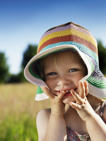 Toddler girl wearing sunhat outdoors