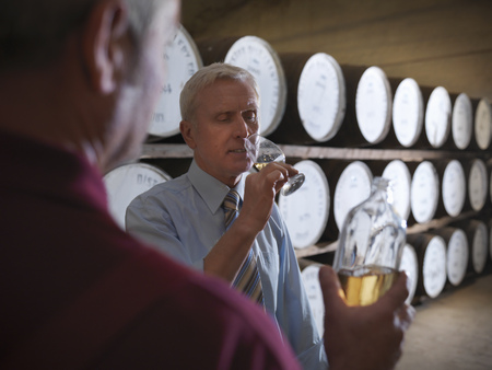 fulfill: Workers checking whisky in distillery