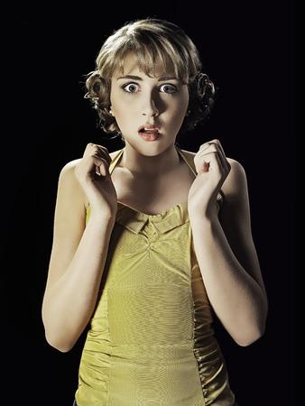 shocks: Frightened girl gasping LANG_EVOIMAGES