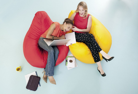 Businesswomen laughing in bean bags