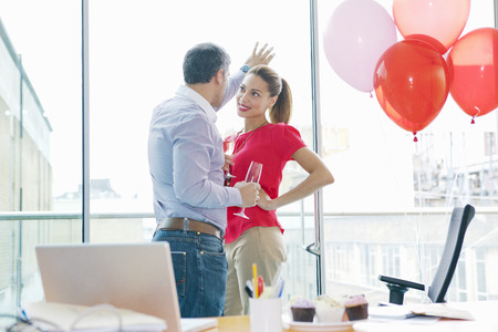 flirtation: Business people flirting at office party