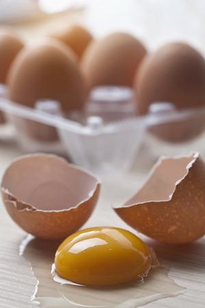 overflows: Close up of broken eggshells and yolk