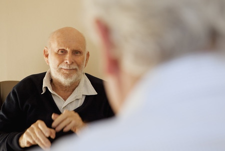 Older men talking indoors