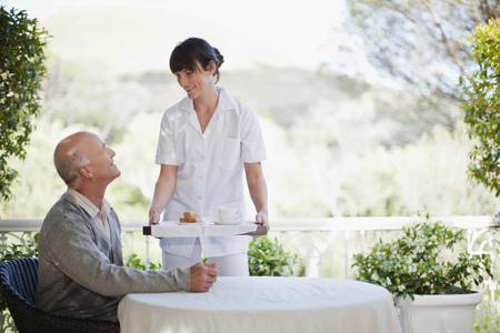 sciences: Waitress serving older man coffee