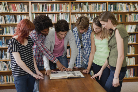 histories: Students reading book in library