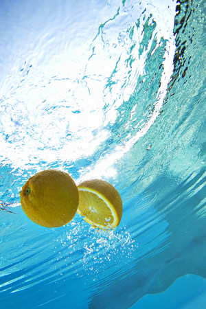 low section: Lemon floating in swimming pool