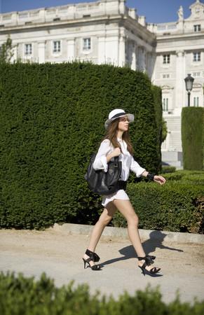 Woman walking by Palacio Real