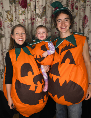 equivalents: Family dressed as pumpkins for Halloween