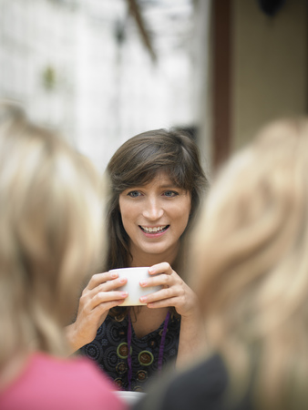 Women having coffee at sidewalk cafe LANG_EVOIMAGES