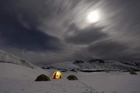 mountainous: Illuminated tent at glacier campsite