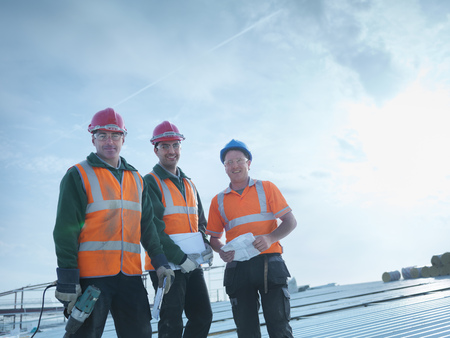 replaced: Workers standing together on roof