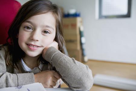 moved: Smiling girl sitting at desk