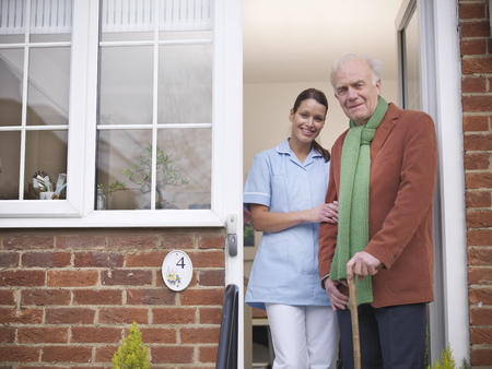 matured: Nurse and older man standing in doorway