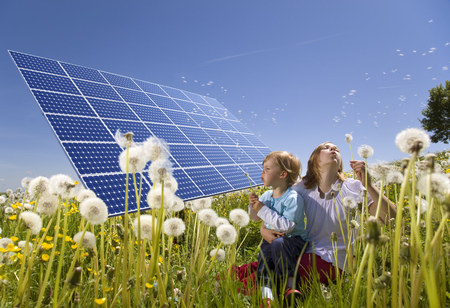 environmentalism: Children in field with solar panels