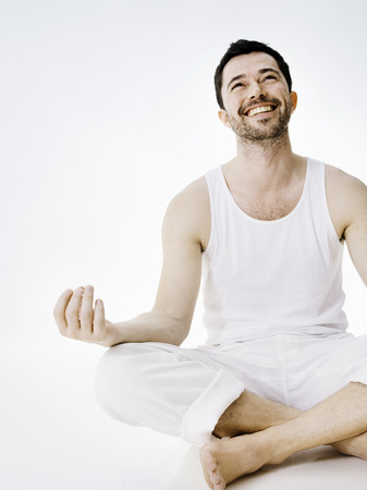 hearted: Smiling man sitting in meditative pose