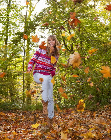 leafed: Woman playing in fall leaves