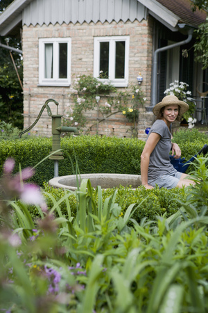 abodes: Woman sitting on pond in backyard