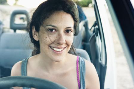 transportation: Smiling woman driving car